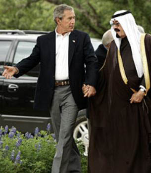 Bush holding hands with Saudi royalty