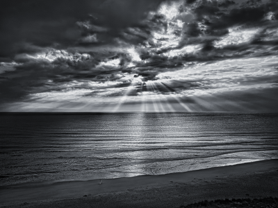 Black and white beach rays of light wallpaper