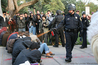 Lt. John Pike using pepper spray on peaceful protesters at UC Davis