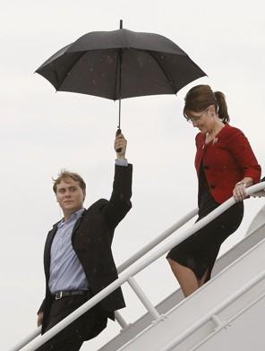 Anti-American loon Sarah Palin with umbrella holder